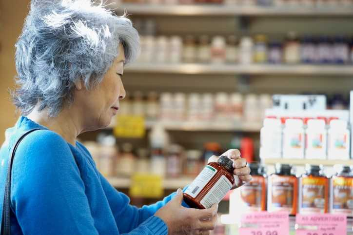 woman looking at dietary supplements
