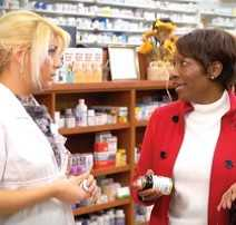 women discussing dietary supplements in a store