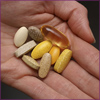 Photo: hand holding dietary supplements