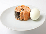 boiled egg and canned salmon on a plate