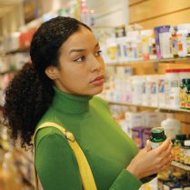 Woman Shopping in Vitamin Section of Drug Store