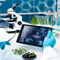 scientist with tablet and plants